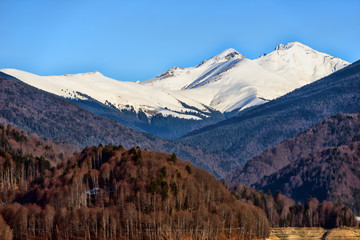 Snow covered mountains and rocky peaks in the Romanian carpatian
