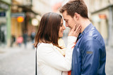 Couple in love kissing on street