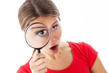 Amazed woman holding a magnifying glass