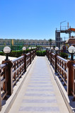 beautiful bridge with wooden railings and lamps