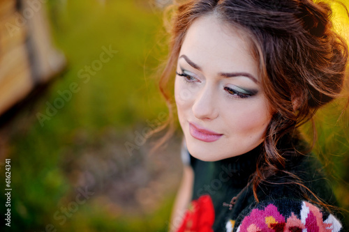 Portrait of a beautiful brunette on natural background