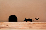 Mouse House in the wall. Silhouette mouse.