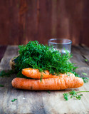 Fresh organic carrots and fennel on  wooden background