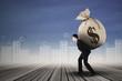 Businessman carrying a money sack