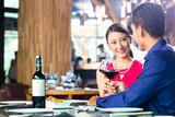 Asian couple fine dining in restaurant - Fine Art prints