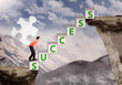 Businessman success puzzle on mountain