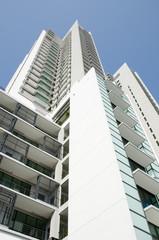 Modern residential condominium with clear blue sky