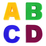 Four letters written in multicolored plastic kids letters