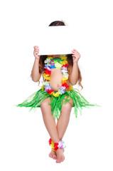 Girl in hawaiian dress sitting on white surface