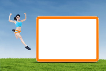 Healthy woman jumping next to copyspace