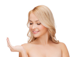smiling woman holding something imaginary
