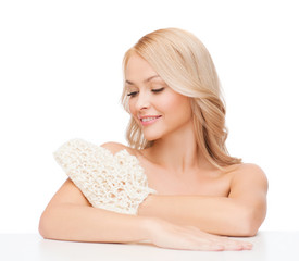 smiling woman with exfoliation glove