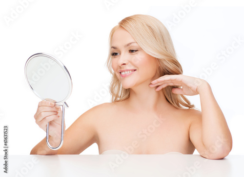 smiling woman looking at mirror