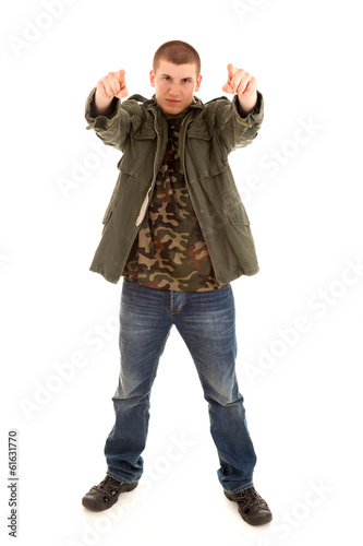 teen man pointing on you, white background