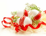 festive eggs decorated with red ribbon Easter holiday