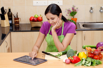 Young Indian woman using a tablet PC
