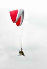 Man with paramotor in the sky