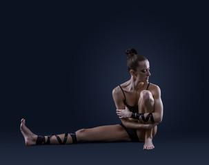 Ballet dancer portrait on dark blue background
