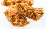 Crunchy chicken strips over light background