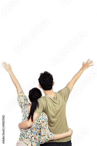 Young couple looking at white background