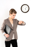 Business woman in hurry looking at her watch, isolated