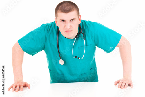 angry young man doctor, white background