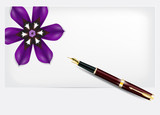 paper with a purple flower and pen