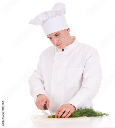 male cook cutting dill, white background
