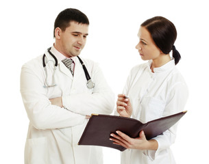 Successful doctors discussing something. - Stock Image