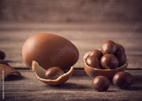 Chocolate Easter Eggs Over Wooden Background