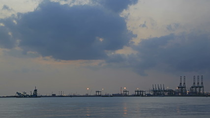 Port of Singapore wih Moving Clouds Evening Time Lapse