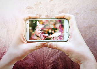 Photo of a girl on the phone screen