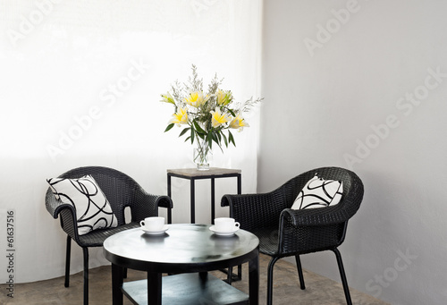 Garden furniture chairs in simple setting