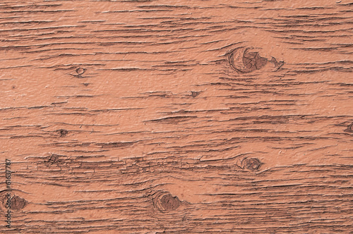 Old weathered plywood surface with faded paint as background