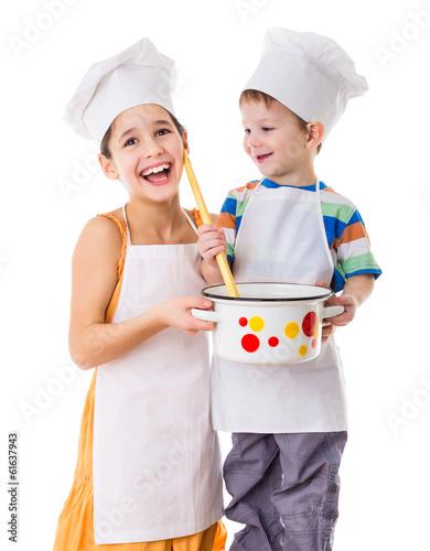 Fotobehang Koken Two kids with pan and big ladle