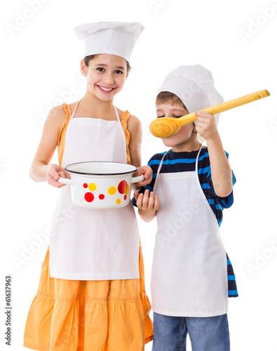 Fotobehang Koken Kids with pan and big ladle
