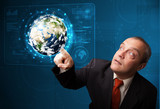 Businessman touching high-tech 3d earth panel