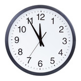 Clock face showing the hands at five minutes to midnight