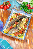 Fish. Roasted mackerel and tomatoes with garlic, basil and lemon