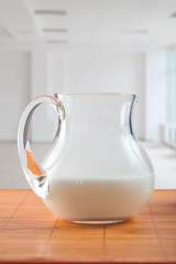 pitcher with milk on table