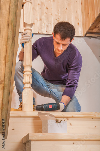 young worker drilling with cordless drill