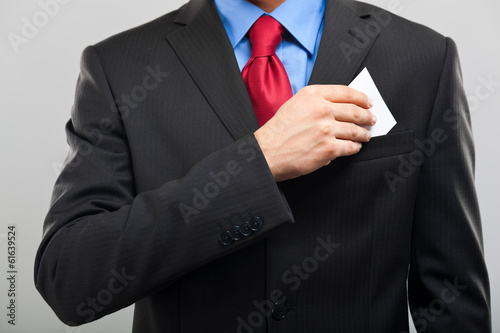 Businessman taking a business card