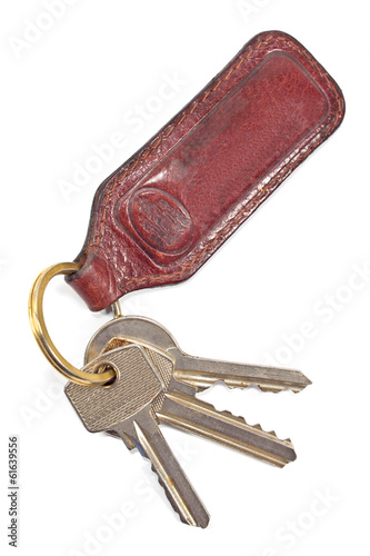 Keys with leather tag isolated on white