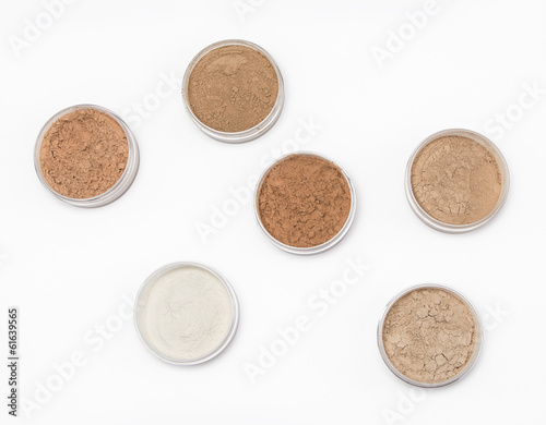 Loose cosmetic powder in jars