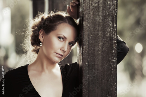 Portrait of sad beautiful young woman outdoor