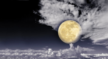 Full moon in the clouds. Abstract background.