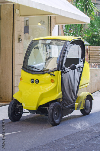 Small postal electric car.
