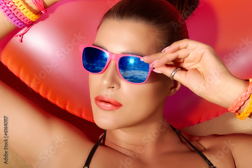 Fashion Girl Portrait. Beautiful Young Woman Sunbathing