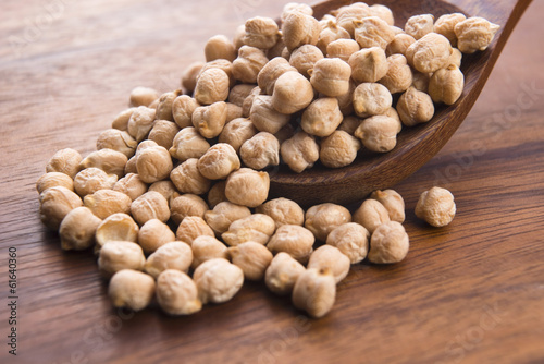 dried white chickpeas ceci on the wooden spoon