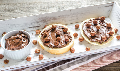 Bun slices with chocolate cream and nuts